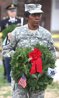 Sgt. Cynthina Bell Hawkins lays a remembrance wreath in memory of those who served and are serving in the United States Coast Guard.