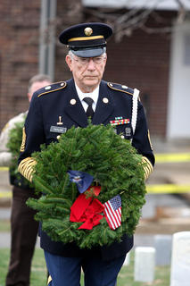 Command Sgt. Major Ernest Taylor retired lays a remembrance wreath in memory of those who served and are serving in the United States Merchant Marines.