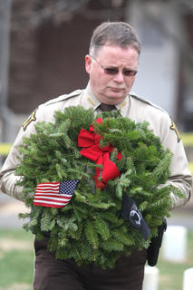 In honor of fallen Deputy Anthony Rakes, Sheriff Jimmy Clements, lays a remembrance wreath in honor of the 93,129 United States servicemen from all branches of the service who last know status ere either Prisoners of War or Missing in Action. These individuals have never returned to their families and homes. 