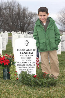 Aiden Phillips, 6, stands beside his grandfather&#039;s headstone at Lebanon National Cemetery. His grandfather, Todd Lanham, passed away on Sept. 3, 2011.