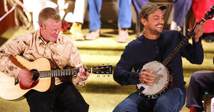 Nathan Yaste plays the guitar while Brad Spalding plays the banjo.