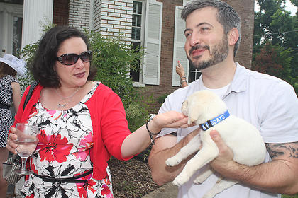 "Roderick Saylor's party accessory was his new puppy ""Samus."""