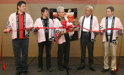 The annual Japanese Cultural Day was postponed due to the earthquake and tsunami that affected Japan earlier this year. Nevertheless, participants in Sunday's event got to experience dancing, martial arts, food and fun at Centre Square. From left, AJ Obata, Yushihito Kajita, Takashi Fujii, Satoshi Hattori and Tatsutoshi Takashima cut a ribbon to start the celebration.