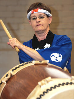 Helen Rindsberg, co-director of the Cincinnati-Dayton Taiko Drummers, performs a song.