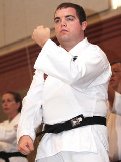 Tony Ballard leads a kata during a demonstration by John Cox Martial Arts students.