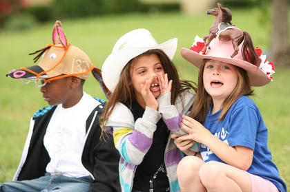 Lebanon Elementary School held its own Derby parade May 6. From left, Kanyon Spalding watches the floats, as Natalie Gray and Maggie Overstreet shout words of encouragement.