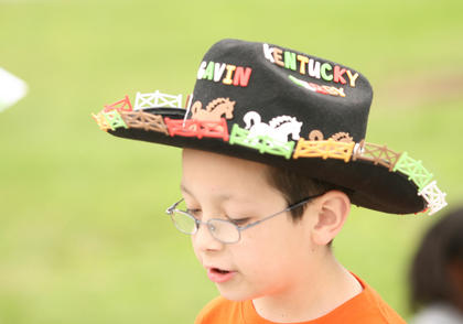 Gavin Bardin topped his Derby look with a decorated cowboy hat.