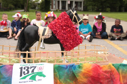 Michelle Pierce's class affixed a garland of roses on the horse for their float.