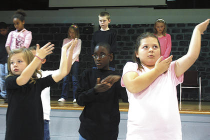 LES students perform a sign language routine during a Marion County Board of Education meeting Nov. 9. The Betty Jo Higdon memorial bench was dedicated as part of that meeting.