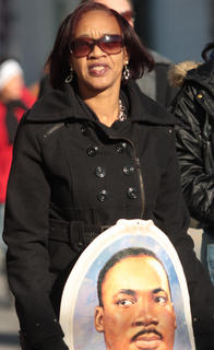 Jackie Furman carries an image of Martin Luther King during the march.