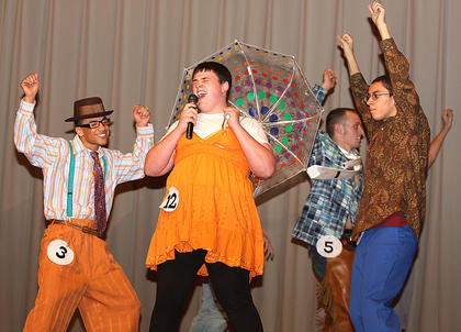 "Jared May performs an original dance and vocal routine to ""It's Raining Men"" during the talent portion of the competition. He won a talent award."