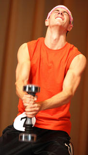 Denny Thompson performs an original fitness routine with the Shake Weight during the talent competition.