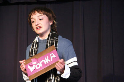 Charlie Bucket (Rebecca Bowman) prepares to open one last Wonka bar ...