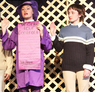 Willy Wonka (Allison Martell) requires the golden ticket winners, including Charlie Bucket (Rebecca Bowman, right), before touring his factory.
