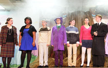 "The St. Augustine School eighth graders performed ""Willy Wonka Jr.""  May 10 at the parish center. Inside the factory, from left, Mrs. Beauregard (Leah Mudd), Violet Beauregard (Shaniqua Young), Grandpa Joe (Jacob Benningfield), Willy Wonka (Allison Martell), Charlie Bucket (Rebecca Bowman), Veruca Salt (Mary Beth Childers) and Mr. Salt (Aaron Spalding)."