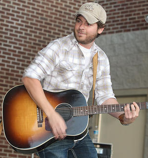 Josh London entertains the crowd during the Country 100.9 Mike FM/Miller Lite Battle of the Bands. The Josh London band won the battle and received a $1,000 prize, trophy and the honor of opening for Jason Michael Carroll at the Ham Jam on Saturday night.