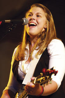Allison Stafford of No Deceit sings during the Battle of the Bands competition Friday evening.