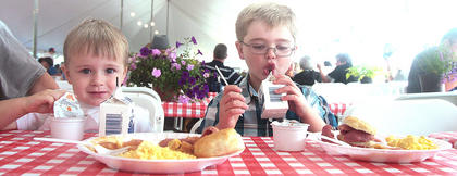 Cousins Andrew Adams, 3, and Bryce Keeling, 8, of Louisville visited their grandparents and enjoyed a ham breakfast.