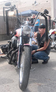 Garrett Thompson prepares his motorcyle for judging on Sunday morning.