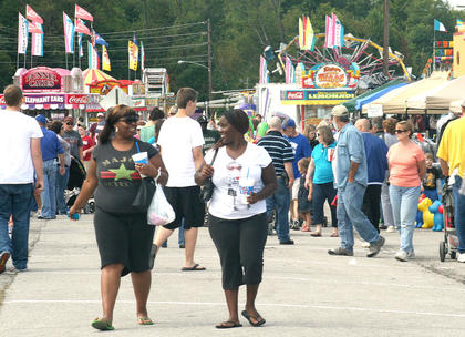 Shelerra Furman and Shenquella Tongue enjoy a stroll through the flea market.