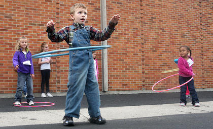 Jacob Morgan had the right technique to win his age group in the hula hoop contest.