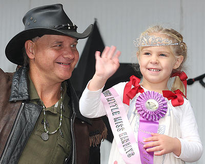 "Emily Grace Mattingly waves to the crowd after being crowned Little Miss Ham Days by Ernie ""Turtle Man"" Brown. Mattingly is the 4-year-old daughter of Bruce and Robin Mattingly."