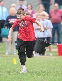 Jacob Goodin of West Marion Elementary School gives his all during his leg of the Pig Pen Relay held Sept. 20.
