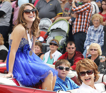 Christine Mattingly is sitting pretty as the grand marshal for the Pigasus Parade Saturday afternoon. Mattingly is the 2011 Marion County Junior Miss and the 2011 Kentucky Distinguished Young Woman. Also pictured is Mattingly's brother, Kelly, and mother, Carol. Not pictured is her father, Joe, who was driving.