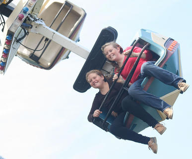 Hannah and Brianna Mattingly go for a ride on the Star Trooper.