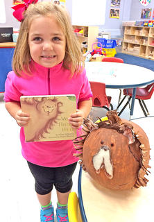 """Annaleece Myers is pictured with her """"Very Hairy Bear"""" pumpkin."""