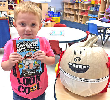 """Owen Thompson is pictured with his """"Captain Underpants"""" pumpkin."""