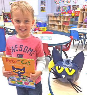 """Parker Buckman is pictured with his """"Pete the Cat"""" pumpkin."""