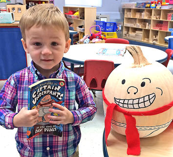 """Connor Sizemore is pictured with his """"Captain Underpants"""" pumpkin."""
