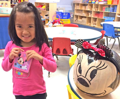 """Irene Chea is pictured with her """"Minnie Mouse"""" pumpkin."""