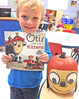"""Kingston Simmerman is pictured with his """"Otis and the Kitten"""" pumpkin."""