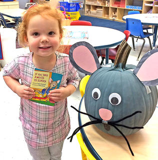 """Kylie Reed is pictured with her """"If You Take a Mouse to School"""" pumpkin."""