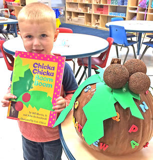 """Matthew Sapp is pictured with his """"Chicka Chicka Boom Boom"""" pumpkin."""