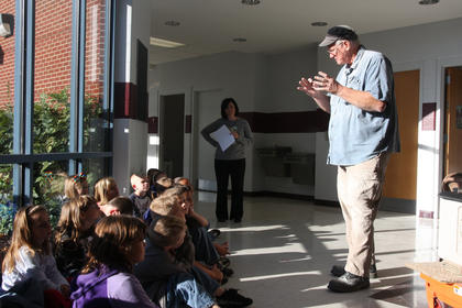 Al Nelson speaks with LES students recently. He and his wife spent a week working on the memorial bench and incorporating the students and staff into the project.