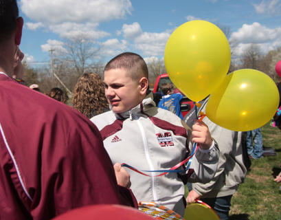 Logan Hall waits for the balloon release.