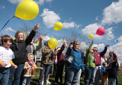 To conclude Saturday&#039;s event, participants gathers for a balloon release.
