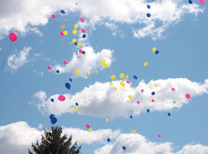 Multi-colored balloons drifted into the sky at the conclusion of the autism walk.