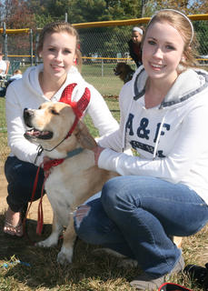 Madison (left) and Morgan Avritt keep an eye on Jerry, an animal they got from the Marion County Animal Shelter.
