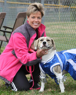 Benita Clark and her dog, Lucy, pose with a smile before the events begin.