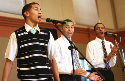 From left, Dallon Goldring, Guyron Spalding and Michael Wright of the Young Men of Faith sing Sunday during the Black History Celebration at Centre Square.