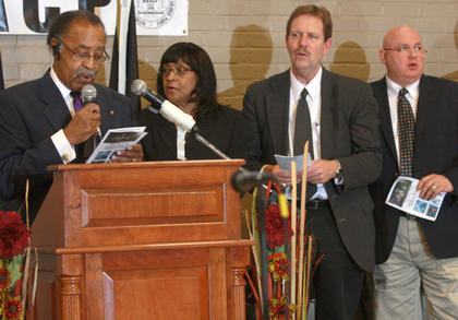 "NAACP Chapter President Jerry Evans leads the singing of ""Lift Every Voice"".  Lynn Wingard, Marion County Judge/Executive John G. Mattingly and Lebanon Mayor Gary Crenshaw are also pictured."