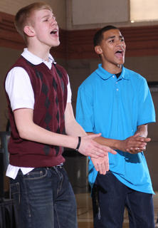 Adam Hicks and Dallan Goldring of the Young Men United sing during the opening the Black History Celebration Feb. 27 at Centre Square.