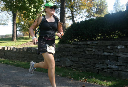 A runner with the Racing Turtles passes through Maker's Mark Distillery during the 2011 Bourbon Trail.