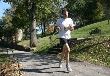 A runner passes through Maker&#039;s Mark Distillery during the 2011 Bourbon Trail.  He is a member of MMM Bourbon.