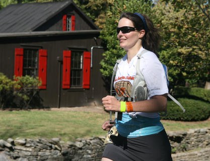 A runner passes through Maker's Mark distillery on Friday afternoon during her leg of the Bourbon Chase. She is a member of Bourbon IQ.