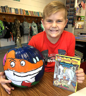 """West Marion Elementary School student Charlie Mattingly is pictured with his Geronimo Stilton-themed pumpkin from""""The Karate Mouse"""" book."""